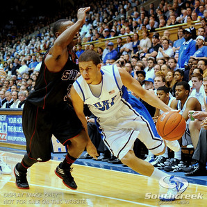 Duke Blue Devils Guard Seth Curry (J) dribbles past NC State Wolfpack Guard Alex Johnson during the basketball game between the Duke Blue Devils and the NC State Wolfpack at Cameron Indoor Stadium, Durham NC.  Duke came from 20 points behind with 11 minutes remaining to win the game, 78-73.
