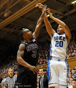 Duke Blue Devils Guard Andre Dawkins (J) shoots a field goal during the basketball game between the Duke Blue Devils and the NC State Wolfpack at Cameron Indoor Stadium, Durham NC.  Duke came from 20 points behind with 11 minutes remaining to win the game, 78-73.