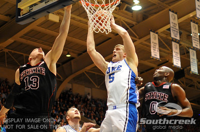 Duke Blue Devils Forward Mason Plumlee (J) grabs a rebound during the basketball game between the Duke Blue Devils and the NC State Wolfpack at Cameron Indoor Stadium, Durham NC.  Duke came from 20 points behind with 11 minutes remaining to win the game, 78-73.