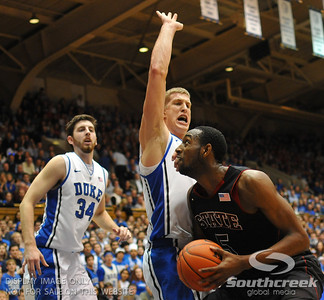 NC State Wolfpack Forward C.J. Leslie tries to score against Duke Blue Devils Forward Mason Plumlee (J) during the basketball game between the Duke Blue Devils and the NC State Wolfpack at Cameron Indoor Stadium, Durham NC.  Duke came from 20 points behind with 11 minutes remaining to win the game, 78-73.