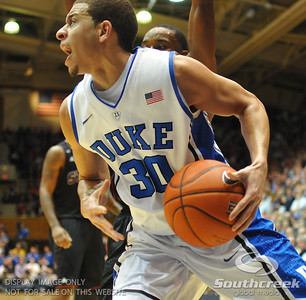 Duke Blue Devils Guard Seth Curry (J) drives to the basket during the basketball game between the Duke Blue Devils and the NC State Wolfpack at Cameron Indoor Stadium, Durham NC.  Duke came from 20 points behind with 11 minutes remaining to win the game, 78-73.
