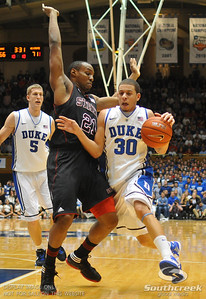 Duke Blue Devils Guard Seth Curry (J) is defended by NC State Wolfpack Guard C.J. Williams during the basketball game between the Duke Blue Devils and the NC State Wolfpack at Cameron Indoor Stadium, Durham NC.  Duke came from 20 points behind with 11 minutes remaining to win the game, 78-73.