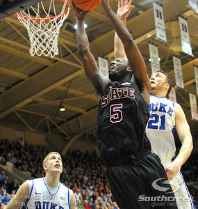 NC State Wolfpack Forward C.J. Leslie scores against Duke Blue Devils Forward Miles Plumlee (S) during the basketball game between the Duke Blue Devils and the NC State Wolfpack at Cameron Indoor Stadium, Durham NC.  Duke came from 20 points behind with 11 minutes remaining to win the game, 78-73.
