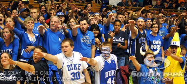 Fans get excited during the basketball game between the Duke Blue Devils and the NC State Wolfpack at Cameron Indoor Stadium, Durham NC.  Duke came from 20 points behind with 11 minutes remaining to win the game, 78-73.