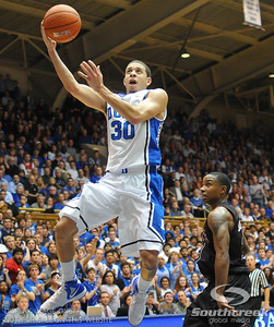 Duke Blue Devils Guard Seth Curry (J) scores during the basketball game between the Duke Blue Devils and the NC State Wolfpack at Cameron Indoor Stadium, Durham NC.  Duke came from 20 points behind with 11 minutes remaining to win the game, 78-73.