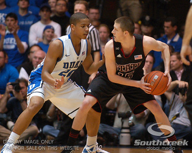 Duke Blue Devils Guard Andre Dawkins (J) defends against NC State Wolfpack Forward Scott Wood during the basketball game between the Duke Blue Devils and the NC State Wolfpack at Cameron Indoor Stadium, Durham NC.  Duke came from 20 points behind with 11 minutes remaining to win the game, 78-73.