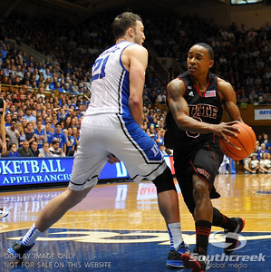 NC State Wolfpack Forward C.J. Leslie is defended by Duke Blue Devils Forward Miles Plumlee (S) during the basketball game between the Duke Blue Devils and the NC State Wolfpack at Cameron Indoor Stadium, Durham NC.  Duke came from 20 points behind with 11 minutes remaining to win the game, 78-73.