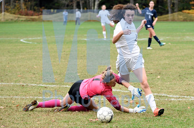 Jeb Wallace-Brodeur / Staff Photo Harwood freshman Ashley Proteau gets fouled by Fair Haven keeper Emma Ezzo during the second half of their playoff game Wednesday. The foul resulted in a successful penalty kick from Harwood senior Keara Hallam.