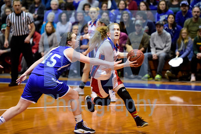 Jeb Wallace-Brodeur / Staff photo Hazen junior Lizzie Brown drives to the hoop past the defense of Thetford senior Kate Vaughan during the first half of their Div. III semifinal game in Barre Thursday.