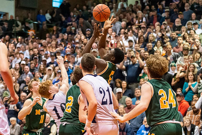 Montpelier's Leo Riby-Williams snatches a rebound against Fair Haven during the DII Boys Basketball final at the Barre Auditorium on Saturday.