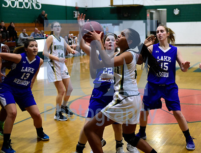 Jeb Wallace-Brodeur / Staff Photo Montpelier sophomore Azwayla Taylor shoots over the defense of Lake Region freshman Tia Martinez during the first half of their game Thursday.