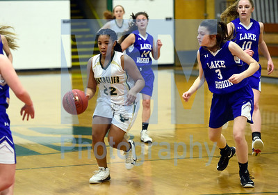 Jeb Wallace-Brodeur / Staff Photo Montpelier freshman Aaliyah Shannon dribbles past the defense of Lake Region freshman Robin Nelson during the first half of their game Thursday.