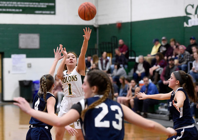 Montpelier senior Mikaela Luke-Currier shoots a jumper over the defense of Randolph junior Hailey Vesper, left, during the second half of their game Friday.