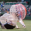 Navigators players Nate Rossi; left; and Cole Bradley participate in bubble soccer in between innings at Friday's game.