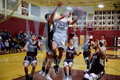 Jeb Wallace-Brodeur / Staff Photo Northfield senior Nick Medow gets fouled by BFA Fairfax sophomore Cam Meunier as he drives to the basket during the first half of their game Thursday.