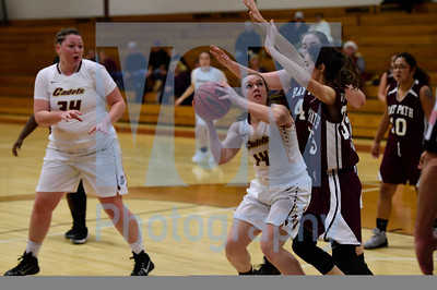 Jeb Wallace-Brodeur / Staff Photo Norwich University senior and Spaulding High School graduate Paige McNally looks to put up a shot against the defense of Bay Path junior Haleigh Bassett during the first half of their game in the Ed Hockenbury Classic on Friday night.