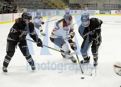Jeb Wallace-Brodeur / Staff Photo Norwich University sophomore Carly Menges works the puck through the defense of Franklin Pierce freshman Bridgette Prentiss, left, and senior Nina Danforth during the first period of their game Friday.