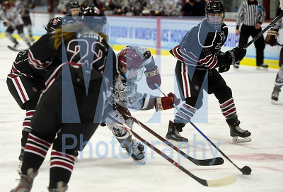 Jeb Wallace-Brodeur / Staff Photo Norwich University senior Sarah Schwenzfeier operates in traffic during the first period of the Cadets' NCAA seminfinal game against Hamline University Friday.