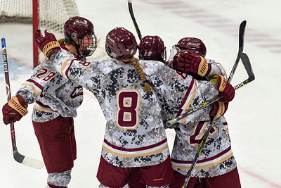 Norwich Cadets celebrate Sophie McGovern's first period goal against Suffolk during Saturday's NEHC championship in Northfield.