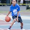 Kanye Wavezwa brings the ball up the court.