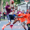 Curtis High of the Young Gunz high school team flies to the hoop