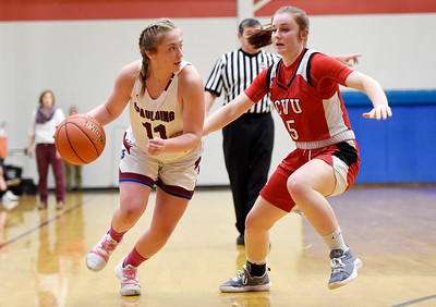 Spaulding freshman Sage MacAuley drives around the defense of CVU senior Maryn Askew during the first half fo their game Wednesday.