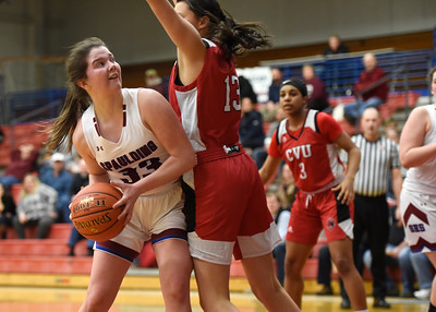 Spaulding junior Josie Diego works the low post against the defense of CVU senior Bray Hunter during the first half of their game Wednesday.