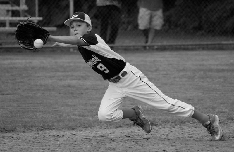 Swampscott shortstop Nate Marston makes a diving effort on a line drive base hit.