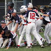 Swampscott catcher Connor Correnti (2) is swarmed by teammates after knocking in the winning run in the eighth inning.