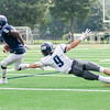 Swampscott's Emmanuel Teshowa evades the tackle attempt of Jared Durkin.