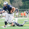 Triton's Jack Tummino can't get a piece of Swampscott quarterback Colin Frary as he scampers toward the end zone.