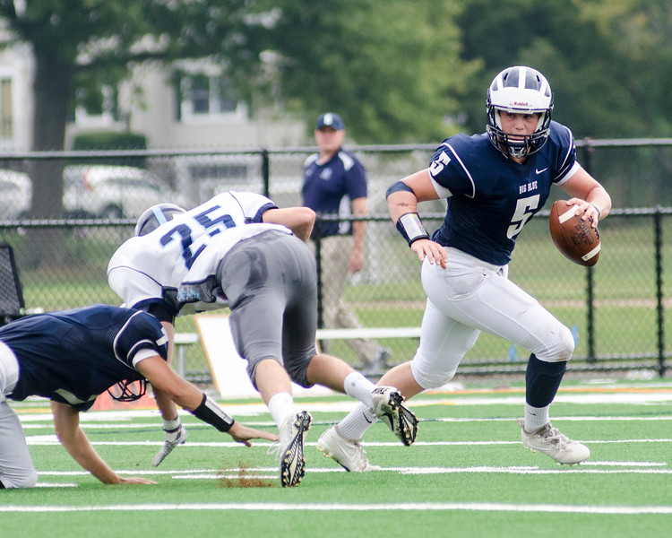 Swampscott quarterback Colin Frary looks for an open pass.