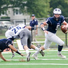 Swampscott quarterback Colin Frary looks for an open pass.