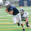 Swampscott's Isaiah Bascon barrels into the end zone as Sammy Rennick tries to make the tackle.