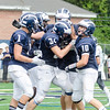 Dominic Codispoti, center, is mobbed by teammates, from left, Lucas Cote, Kwest Tyler-Lacy, Alex Sheehan and Ethan Friedman after making an interception.