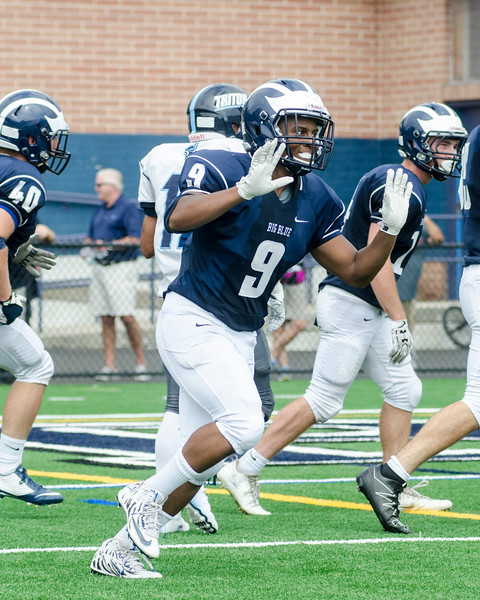 Swampscott's Isaac Andre reacts after the Big Blue's punt was downed at the 1 yard line.