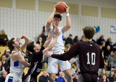 U-32 junior Owen Kellington pulls down a rebound in traffic during the second half of the Raiders' game against Lyndon Thursday.