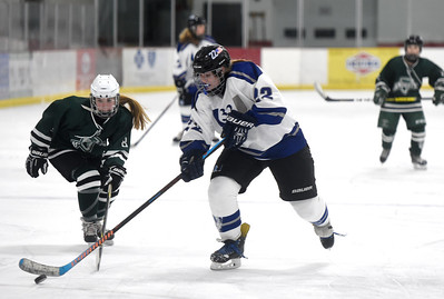 U-32 sophomore Allie Guthrie skates past the defense of Rice freshman Grace Nigolian enroute to scoring a first-period goal on Wednesday.