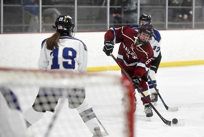 Spaulding sophomore Zoe Tewksbury takes a shot on goal past the defense of U-32 junior Cadence Burgess during the first period of their game Wednesday.
