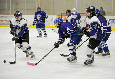 Jeb Wallace-Brodeur / Staff Photo U-32 senior Jordyn Michaud, left, handles the puck as Missisquoi sophomore Callie Parks and U-32 sophomore Payton Kurrle give chase during the first period of their game Wednesday.