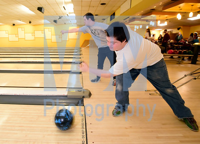 Jeb Wallace-Brodeur / Staff Photo U-32's Brooke Merrill, right, and Montpelier's Bobby Powell bowl Thursday during the Unified Sports Central Vermont Bowling Tournament at Twin City Lanes in Berlin.