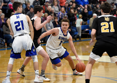 Williamstown senior Jacob Tassie drives the lane as junior teammate Riley Cheney sets a pick on Harwood freshman Cole Hill during the first half of their game Thursday.