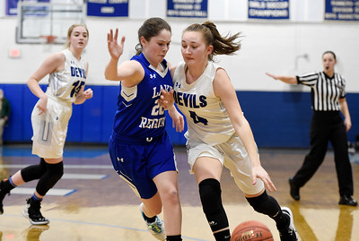 Williamstown junior Jazlyn Locarno drives around the defense of Lake Region junior Tia Martinez during the first half of their game Friday.