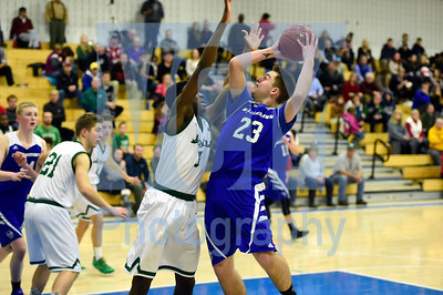 Jeb Wallace-Brodeur / Staff Photo Williamstown senior Kail Johnson shoots over the defense of Montpelier freshman Leo Riby-Williams during the second half of the Blue Devils' 80-60 win in the Corey Plante Memorial Tournament Friday.