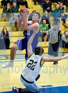 Jeb Wallace-Brodeur / Staff Photo Williamstown senior Nathan Poulin gets fouled by Montpelier junior David Ackerson as he drives to the hoop during the second half of the Blue Devils' 80-60 win in the Corey Plante Memorial Tournament Friday.