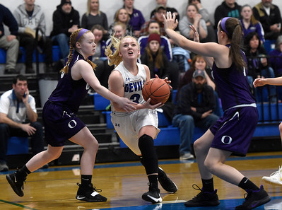 Williamstown sophomore Eliza Dwinell splits a pair of Oxbow defenders as she drives to the basket during the first half of their game Wednesday.