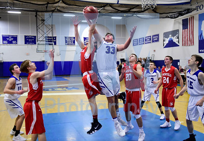 Jeb Wallace-Brodeur / Staff Photo Williamstown senior Nathan Poulin and Twinfield senior Carter Martin fight for a rebound during the first half of their game Thursday.