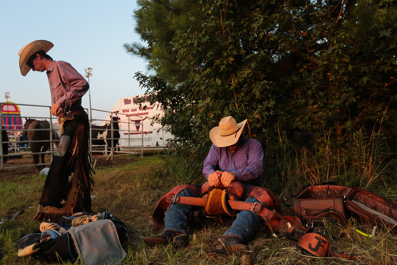 Nadav Soroker/Times-Georgian<br /> <br /> Shane Kuhn and Robert Tucker prepare for their rides behind the chutes at the Don-Rich Ford Villa Rica Frontier Days Rodeo in Villa Rica, on Saturday, August 25, 2018.