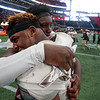 Nadav Soroker/Times-Georgian<br /> <br /> Heard County Braves celebrate their defeat over the Rockmart Yellowjackets to take home the GHSA AA championship trophy at Mercedes-Benz Stadium on Wednesday, December 12, 2018.