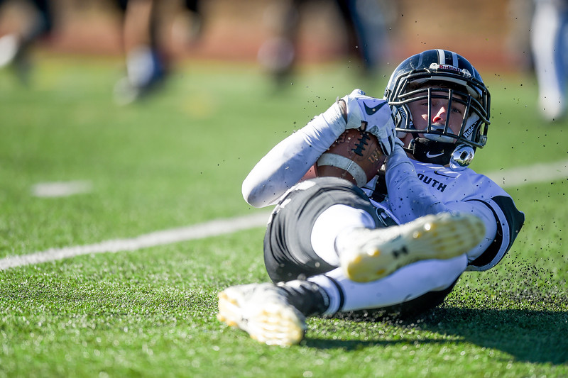 Pueblo South player Jeremy Cody (88) rolls on the grass after catching a low pass at Vista Ridge High School on Saturday, November 18, 2017. The Vista Ridge Wolves lost 35-14 against the Pueblo South Colts.<br /> <br /> (The Gazette, Nadav Soroker)
